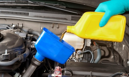 Basic Oil Change, State Emissions Inspection, or Both at Bison Automotive (Up to 49% Off)