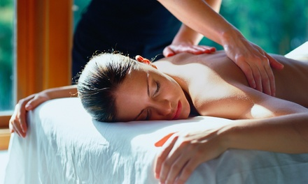 $75 for Massage, Chiropractic Exam, and Three Treatments at Foland Chiropractic and Spa (Up to $330 Value)