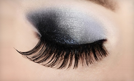Classic or Premium Eyelash Extensions at Beach Bum Tanning (Up to 66% Off). Two Locations Available.