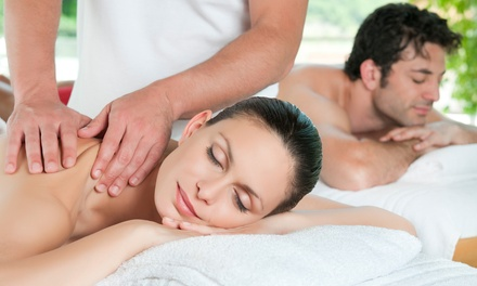 Couples Massage with Aromatherapy or Therapeutic Massage and Custom Facial at East2West Massage & Wellness (60% Off)