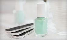 One or Two Classic Manicures and Pedicures at Evolve Salon (Up to 57% Off)
