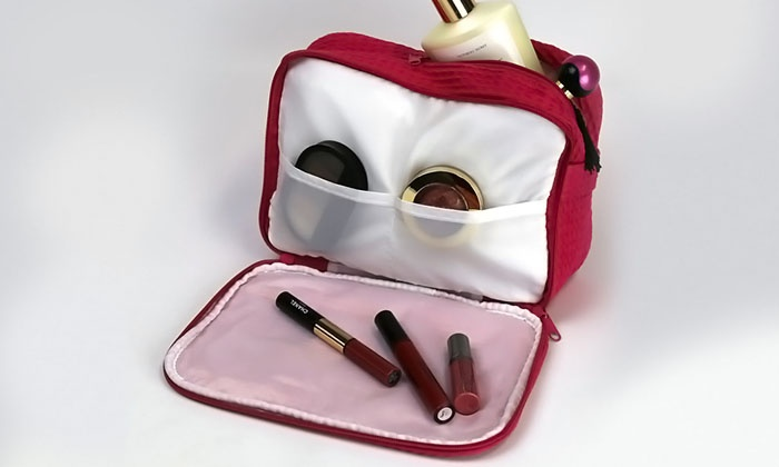 Monogram makeup bag