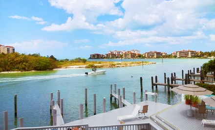 groupon daily deal - Stay at The Boat House Motel on Marco Island in Florida. Dates into June.