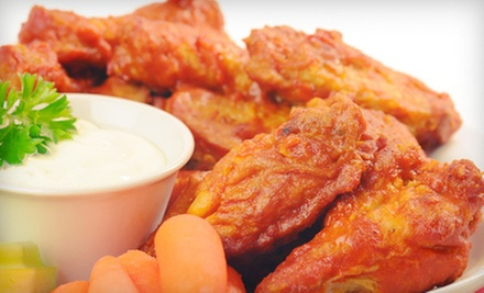 One, Two, or Three Orders of Wings and Beer or $20 for $40 Worth of American Food at Redd's Restaurant & Bar