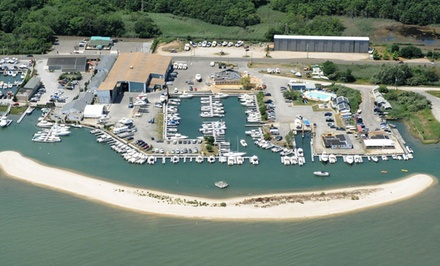groupon daily deal - 1 or 2 Nights for Two in First Mate Suite or Captain's Quarters Room with Dining Credit at Heron Suites in Southold, NY