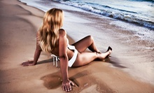 One Month of Unlimited UV and Spray Tanning, One Spray Tan, or Four Spray Tans at Exotic Tans (Up to 65% Off)