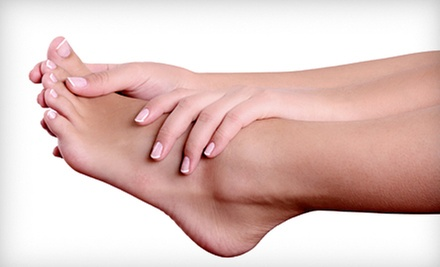 $299 for Laser Toenail-Fungus Removal for Both Feet at Midtown Foot Doctors ($600 Value)