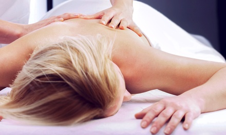 $39 for a Chiropractic Package with a 60-Minute Massage, Exam, and X-rays ($395 Value)