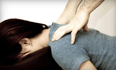 Exam, Consultation, Massage, and Option for Two Spinal Adjustments at The Texas Health Clinics (Up to 81% Off)