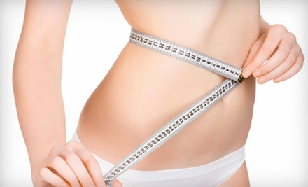 One, Three, or Five Slimming Body Wraps and Red-Light Treatments at Beach Club Tanning (Up to 81% Off)