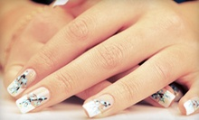 $27 for a Deluxe Manicure and Deluxe Pedicure at Salon Palomo &amp; Day Spa ($70 Value)
