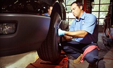 Oil Change Packages or Four-Wheel Alignment at Merlin 200,000 Mile Shop (Up to 64% Off). Four Options Available.