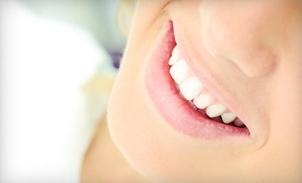 $1,250 for a Dental-Implant Package with Custom Abutment and Crown at Brick Walk Dental Care ($2,526 Value)