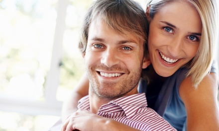$116 for an Adult Dental Package with Teeth Whitening at Harrison Dental ($688 Value)