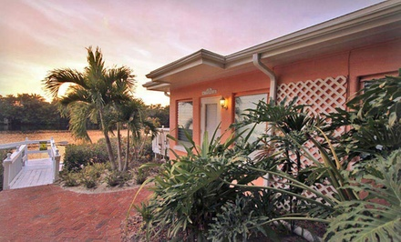 groupon daily deal - 3-, 5-, or 7-Night Stay for Up to Four in a Beach Vacation Bungalow at Siesta Key Bungalows in Siesta Key, FL