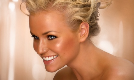 Two or Three Spray Tans, One Month of Level 1 Bed Tanning, or an Airbrush Tan at Bronze Tan (Up to 53% Off)