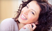 $39 for an In-Office Whiter Image Teeth-Whitening Treatment at Aquarius Tanning Salon and High Tech Spa ($118 Value)
