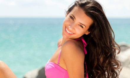 One Month of UV Tanning with Option for Three Spray Tans, or Five Mystic Tans at Tropical Tan (Up to 73% Off)
