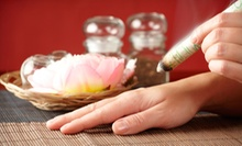 60- or 90-Minute Swedish Massage with Cupping or Moxibustion at Chandra Beauty in Wellness Center (Up to 52% Off)