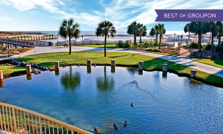 groupon daily deal - Stay at Ocean Creek Resort in Myrtle Beach, SC, with Dates into June