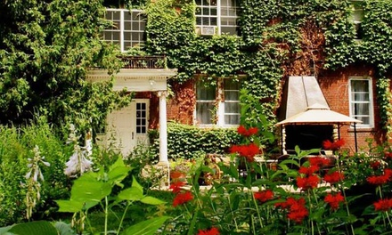 Groupon Deal: 1- or 2-Night Stay for Two in Pablo Picasso, Eva Peron, or Robert Frost Room at The Outing Lodge in Stillwater, MN