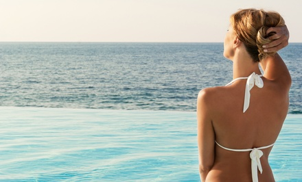 One Month of Unlimited Tanning on a Level 1 Bed or Three Mystic Spray Tans at The Tan Company (Up to 60% Off)