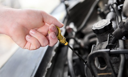 Three Oil Changes with Tire Rotation, Fluids, and Inspection at Brake Stop and Auto Repair (Up to 63% Off)