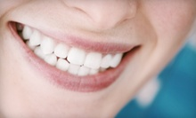 Zoom Teeth Whitening or Dental-Implant Procedure with Porcelain Crown at Smile Arts of NY (Up to 84% Off)
