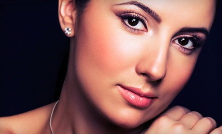 Four or Six Microdermabrasion Treatments at TranZitions Hair Salon (75% Off)