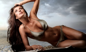 One Month Of Unlimited Uv-bed Tanning, Three Spray Tans, Or Three Fit Body Wraps At House Of Tans (up To 84% Off)