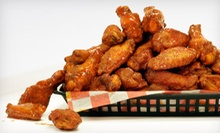 $10 for 12 Boneless Wings, 13 Fish Nuggets and Two Soft Drinks at Wing Busters ($22.37 Value)