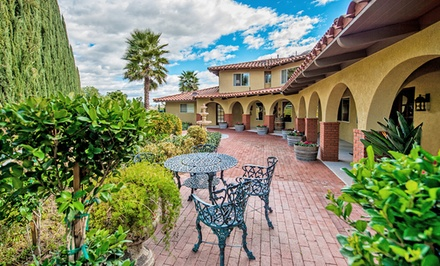 groupon daily deal - 2-Night Stay for Two with Wine and Sangria at The Inn at Europa Village in Temecula, CA