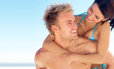 One Spray Tan or One Month of Tanning in a Level 1, 2, or 3 Bed at Sun Kiss'd Tanning ($45.99 Value)