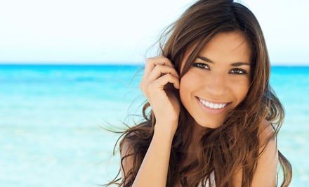 Exam and Cleaning, Take-Home Whitening Package, or Periodontal Treatment at Synergy Dental, PLLC (Up to 86% Off)