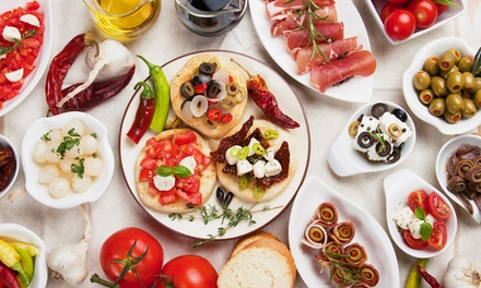 Menu de degustação de petiscos tradicionais ou vegetarianos para 2 ou 4 pessoas desde 14,90 no Mestre André (até -72%)