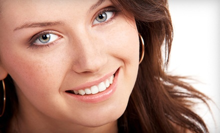 $69 for Beaming White Teeth-Whitening Treatment at Bay Harbor Perfection ($149 Value)
