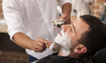 $42 for Haircut and Signature Razor Shave at Dapper & Company Men's Grooming Lounge ($75 Value)