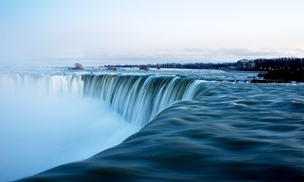 groupon daily deal - Stay with Breakfast at Travelodge Hotel by the Falls in Niagara Falls, ON. Dates into June.