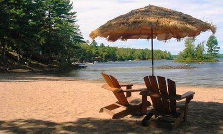 groupon daily deal - 1- or 2-Night Stay for Four with Optional Pontoon Rental or ATV Tour at Springwood Cottages in Arden, ON