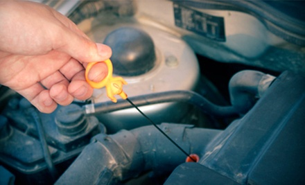 Oil Change with Antifreeze Flush or One or Three Oil Changes with Tire Rotation at MY Automotive (Up to 54% Off)