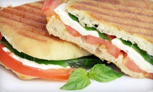 $14 for a Panini or Stromboli and a Take-Home Six-Pack of Beer at Adam Dalton Distillery (Up to $32 Value)