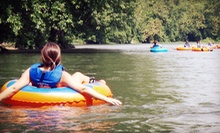 Kayaking or Canoeing, Tubing, and Biking for One, Two, or Four from River &amp; Trail Outfitters (Up to 55% Off)