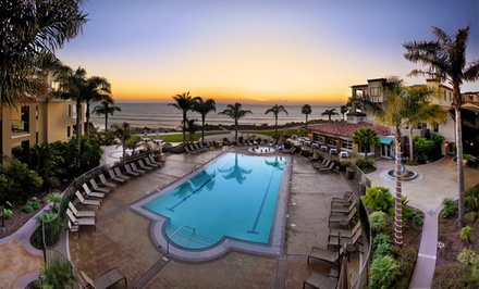 groupon daily deal - 1- or 2-Night Stay for Four in a One-Bedroom Non-Ocean-View Suite at Dolphin Bay Resort & Spa in Pismo Beach, CA