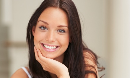 Exam, X-rays, and Cleaning, or an Ultradent In-Office Teeth-Whitening Session at Dental Unlimited (Up to 88% Off)