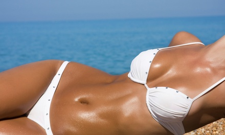 Custom Airbrush Tans or One Week of Tanning at Xotic Tan (Up to 70% Off). Four Options Available.