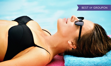 Five UV Tans in Five Levels of Beds or One VersaSpa or Norvell Spray Tan at Darque Tan (Up to 84% Off)