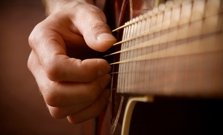 $49 for Four Private Guitar Lessons with Free Lesson e-Book at American Guitar Academy ($129.95 Value)