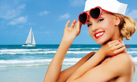 Two Mystic Spray Tans, One Airbrush Tan, or Seven-Day Tanning Pass at Hollywood Tans of Riverdale (Up to 65% Off)