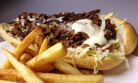 8-in Authentic Philly Cheesesteak with Fries or Salad, Dessert, and Craft Beer for 2 or 4 at Monti's (Up to 50% Off)