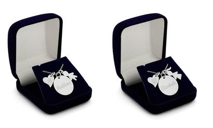 Colar com peça em forma de menina ou menino e um coração e círculo gravados desde 19,99€